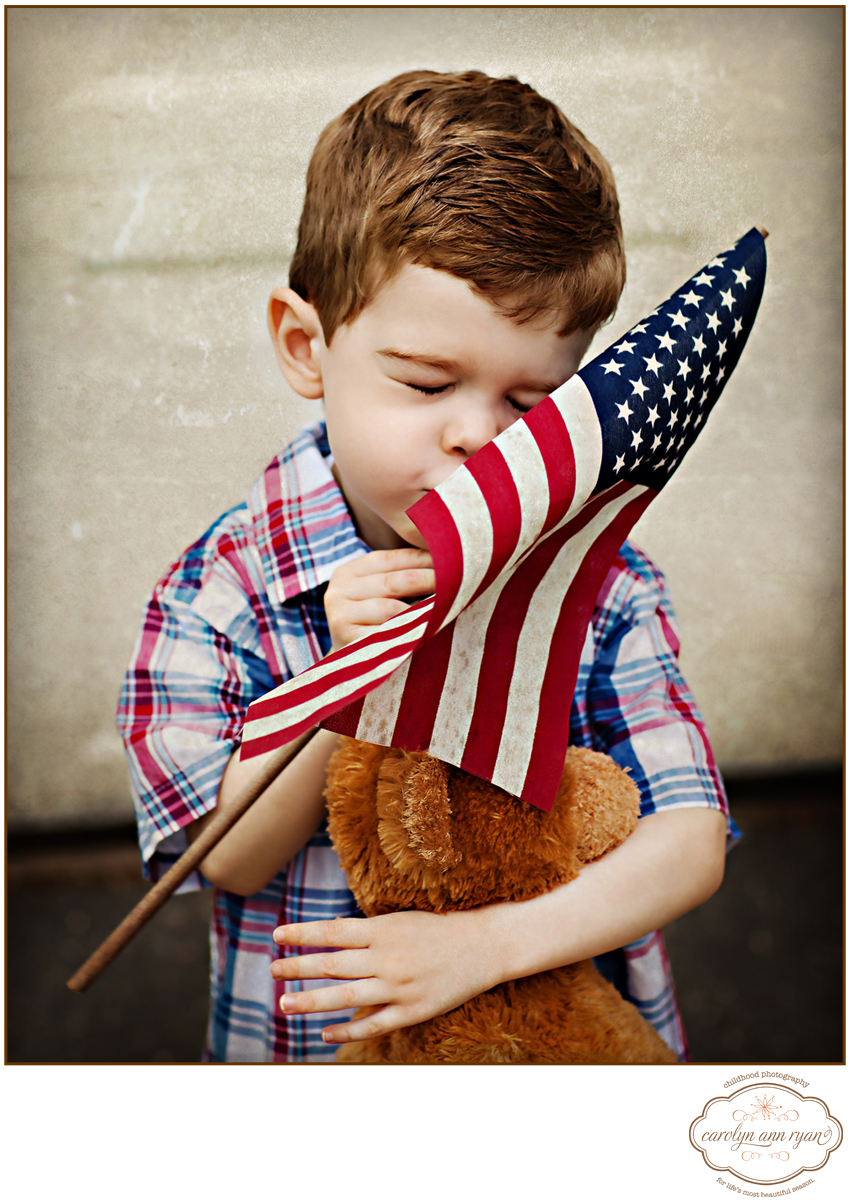North Carolina - Charlotte Metro Area Child Photographer Carolyn Ann Ryan - adorable photograph of little boy teddy bear and American Flag